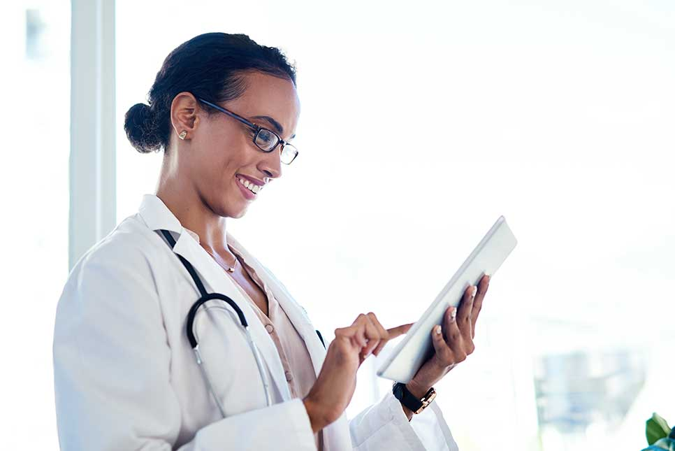 Doctor selecting a publication from a smartphone